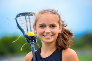 Young girl playing lacrosse